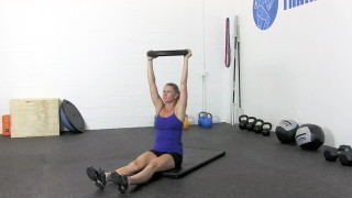 Picture of a female doing Weighted Sit-Ups Exercise