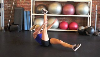 Picture of a female doing Alternating Crunch-Up Exercise