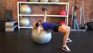 Picture of a female doing Alternating Stability Ball Chest Press Exercise