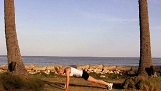 Picture of a female doing Beach Body Weight Burpee Exercise
