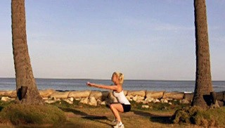 Picture of a female doing Beach Drop Squats Exercise