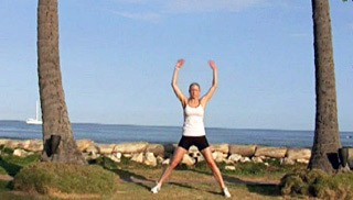 Picture of a female doing Beach Jumping Jacks Exercise