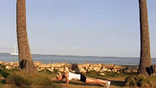 Picture of a female doing Beach Push-ups Exercise