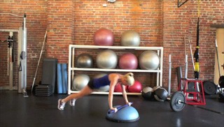 Picture of a female doing Bosu Burpee Shoulder Press Exercise