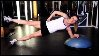 Picture of a female doing Bosu Side Plank with Leg Raise Exercise