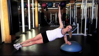 Picture of a female doing Bosu Side Plank with Shoulder Raise Exercise