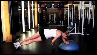 Picture of a female doing Bosu Side Plank with Underside Twist Exercise