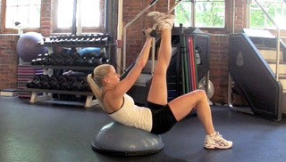 Picture of a female doing Bosu Single Leg Dumbbell Crunch Exercise