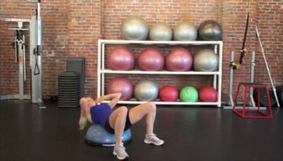 Picture of a female doing Bosu Squat Crunch Exercise