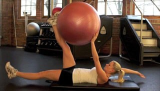 Picture of a female doing Deadbugs w/ Stability Ball Exercise