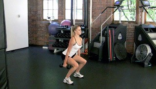 Picture of a female doing Dumbbell Squat and Curl Exercise