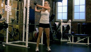 Picture of a female doing Dumbbell Woodchops Exercise