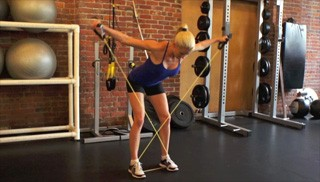 Picture of a female doing Exercise Band Reverse Fly Exercise
