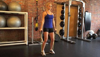 exercise band standing lateral raises - step 1