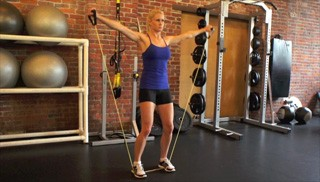 exercise band standing lateral raises - step 2
