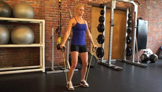 exercise band standing lateral raises - step 3