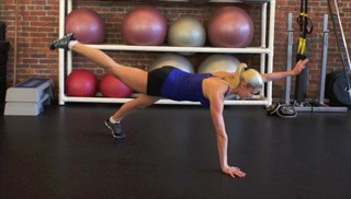 Picture of a female doing Four Point Superman Exercise