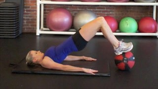 glute bridge on medicine ball - step 2