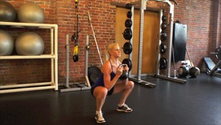 Picture of a female doing Goblet Squat Exercise