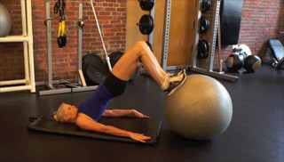 Picture of a female doing Hamstring Curl with Glute Bridge Exercise