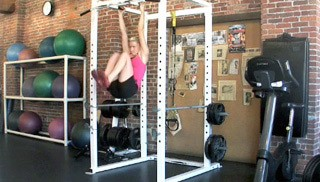 Picture of a female doing Hanging Knee Raise Exercise