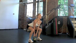 Picture of a female doing Kettlebell Deadlift Exercise