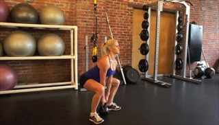 Picture of a female doing Kettlebell Deadlifts Exercise