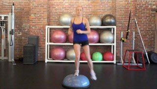 Picture of a female doing Lateral Shuffle on Bosu Exercise