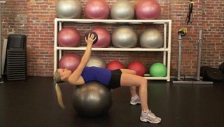 medicine ball crunch on stability ball - step 1
