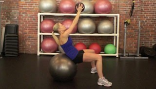 Picture of a female doing Medicine Ball Crunch on Stability Ball Exercise