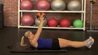 Picture of a female doing Medicine Ball Double Leg Drops Exercise