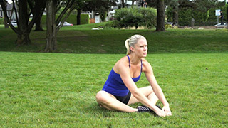 Picture of a female doing Outdoor Butterfly Sit-Ups Exercise