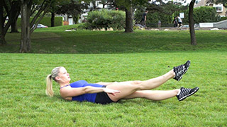 Picture of a female doing Outdoor Fludder Kicks Exercise