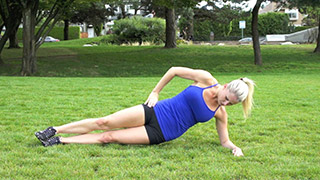 Picture of a female doing Outdoor Side Plank Hip Raise Exercise