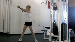 Picture of a female doing Reverse Woodchops Exercise