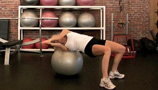 Picture of a female doing Russian Twist on Stability Ball Exercise