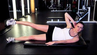 Picture of a female doing Side Crunch with Leg Raise Exercise