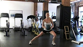 Picture of a female doing Side Medicine Ball Lunge Exercise