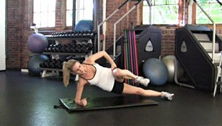 Picture of a female doing Side Plank Knee Drive Exercise