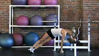 Picture of a female doing Side Plank Twist on Bench Exercise