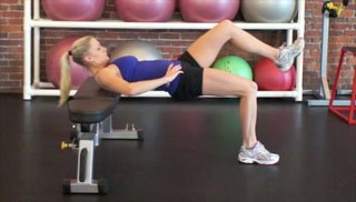Picture of a female doing Single Leg Glute Bridge on Bench Exercise