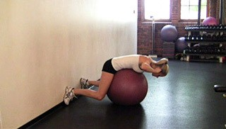 Picture of a female doing Stability Ball Back Extension Exercise