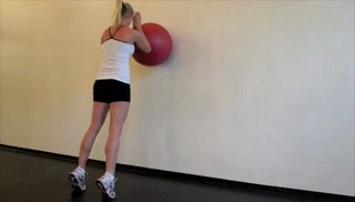 Picture of a female doing Stability Ball Calf Raises Exercise