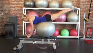 Picture of a female doing Stability Ball Dolphin on Bench Exercise