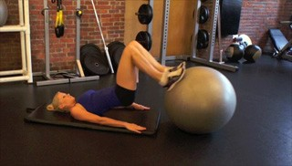 Picture of a female doing Stability Ball Hamstring Curls Exercise