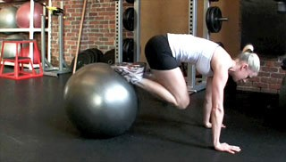 Picture of a female doing Stability Ball Knee Tuck Exercise