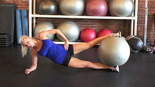 Picture of a female doing Stability Ball Side Plank Hip Raise Exercise