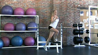Picture of a female doing Step-Over Knee Drive Exercise