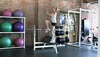 Picture of a female doing Step-Ups With a Hop Exercise