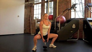 Picture of a female doing Sumo Dumbbell Squat Exercise